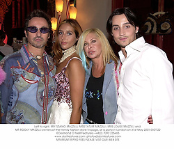 Left to right, MR TIZIANO MAZZILLI, MISS TATUM MAZZILLI, MRS LOUISE MAZZILLI and MR ROCKY MAZZILLI owners of the trendy fashion store Voyage, at a party in London on 31st May 2001.	OOT 22