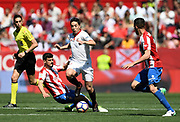 Samir Nasri of Sevilla FC vies with Sergio Alvarez Diaz and Xavi Torres of Sporting Gijon during the Spanish championship Liga football match between Sevilla FC and Sporting Gijon on April 2, 2017 at Sanchez Pizjuan stadium in Sevilla, Spain - photo Cristobal Duenas / Spain / ProSportsImages / DPPI