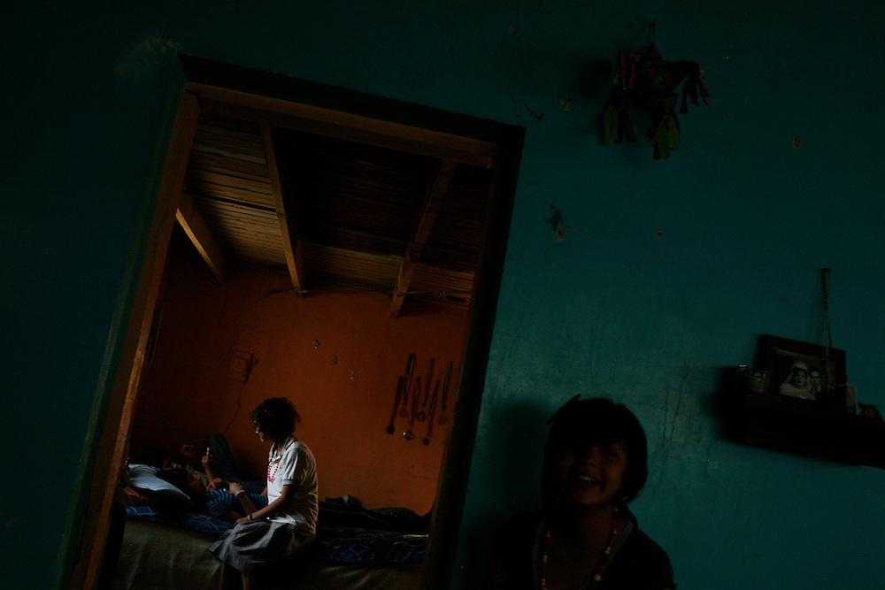 From right, Denise Fuentes, 14 laughs while her friends hang out in a room of her house in the Diaz Ordaz colonia in Ciudad Juarez, Chihuahua Mexico on April 28, 2010.