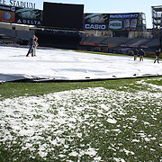 Ground staff clear the infield of ice and snow before the New York Yankees V Chicago Cubs, double header game one at Yankee Stadium, The Bronx, New York. 16th April 2014. Photo Tim Clayton