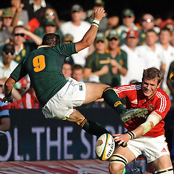 Fourie du Preez of South Africa is tackled by Tom Croft of the British and Irish Lions during the British and Irish Lions tour 2009