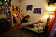 "Paris, France. December 4th 2007.Mariana practices Pole Dance in her apartment with her boyfriend Jean-Baptiste. She is the teacher of the ""Pole Dance Paris"" school.. .Pole Dance Paris.Studio 77 .77 Rue de Montreuil.75011 Paris..www.poledance-paris.com"
