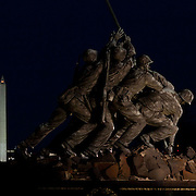 "Arlington, Va., Mar. 19, 20011 - A ""supermoon"" rises over Washington, as seen from the U.S. Marine Corps Memorial Statue in Arlington, Va. on Saturday, Mar. 19, 2011."
