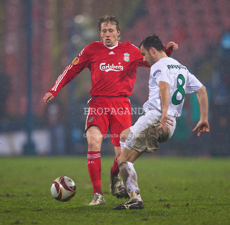 BUCHAREST, ROMANIA - Thursday, February 25, 2010: Liverpool's Lucas Leiva and FC Unirea Urziceni's Sorin Paraschiv during the UEFA Europa League Round of 32 2nd Leg match at the Steaua Stadium. (Photo by David Rawcliffe/Propaganda)