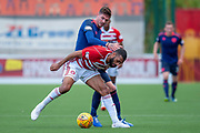 Alex Penny of Hamilton Academical FC holds off Kyle Lafferty of Heart of Midlothian during the Ladbrokes Scottish Premiership League match between Hamilton Academical FC and Heart of Midlothian FC at New Douglas Park, Hamilton, Scotland on 4 August 2018. Picture by Malcolm Mackenzie.