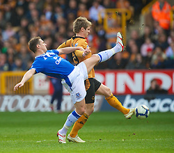 WOLVERHAMPTON, ENGLAND - Saturday, March 27, 2010: Everton's Phil Jagielka and Wolverhampton Wanderers' Kevin Doyle during the Premiership match at Molineux. (Photo by David Rawcliffe/Propaganda)