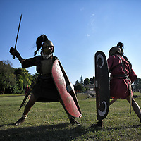 Aquileia, Italy - 17 June 2018: Roman Legionaries with shields, helmets and swords, fight during  Tempora in Aquileia, ancient Roman historical re-enactment