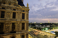 France. Paris. 1st district. Elevated view.  the sun sets over rue de rivoli and the louvre in , as seen from the Hotel Regina.