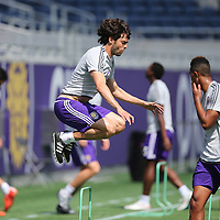 Kaka (10) leaps into the air during the Orlando City Soccer club MLS practice at the Florida Citrus Bowl on Wednesday, March 4, 2015 in Orlando ,Florida. The first season for the Lions is scheduled to begin on March 8, and over 60,000 tickets have been sold for the home opener, though a league wide player strike may occur prior to the beginning of the scheduled season. (AP Photo/Alex Menendez)