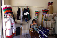 Bolivia. Tarija. Festa di San Roque..Doña Manuela, a dressmaker the district of San Martin, in the days before the party has a lot to do between turbans and feathers to assemble and pack arrows and  costumes Chuncho.