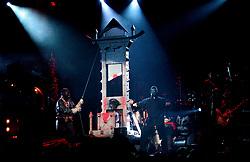 Alice Cooper Stage Show Alice with his head in the Guillotine<br /><br />Alice Cooper DragonTown/ Monsters of Rock Festival. Last night of an eleven date tourat the Hallam FM Arena, SheffieldTuesday 26th Nov<br /><br />Copyright Paul David Drabble<br />Freelance Photographer<br />07831 853913<br />0114 2468406<br />www.pauldaviddrabble.co.uk<br />[#Beginning of Shooting Data Section]<br />Nikon D1 <br />2002/11/26 20:13:58.4<br />JPEG (8-bit) Fine<br />Image Size:  2000 x 1312<br />Color<br />Lens: 80-200mm f/2.8-2.8<br />Focal Length: 135mm<br />Exposure Mode: Manual<br />Metering Mode: Spot<br />1/250 sec - f/2.8<br />Exposure Comp.: 0 EV<br />Sensitivity: ISO 400<br />White Balance: Auto<br />AF Mode: AF-S<br />Tone Comp: Normal<br />Flash Sync Mode: Front Curtain<br />Auto Flash Mode: External<br />Color Mode: <br />Hue Adjustment: <br />Sharpening: Normal<br />Noise Reduction: <br />Image Comment: <br />[#End of Shooting Data Section]