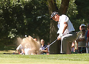 Jul 30, 2005; Grand Blanc, MI, USA; Tjaart van der Walt plays out of the sand on the eigth hole during play Saturday at the 2005 Buick Open. Copyright © 2005 Kevin Johnston