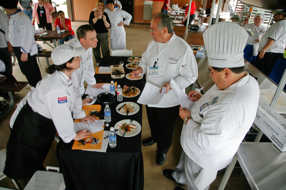 High school students from some of San Antonio's high school culinary programs realax while chefs Christina Perrington (l. to r.), Yancy Voges, Jerry Olivarri, and Ray Salinas, deliberate, during the City South Festival Culinary Competition, held at Brooks City-Base, Texas on March 25, 2007. The students competed for St. Philip's College Culinary School scholarships.  Judging was performed by chefs from the San Antonio Chapter of the Texas Chefs Association.  (Photos/Lance Cheung) ..PHOTO COPYRIGHT 2007 LANCE CHEUNG.This photograph is NOT within the public domain..This photograph is not to be downloaded, stored, manipulated, printed or distributed with out the written permission from the photographer. .This photograph is protected under domestic and international laws.