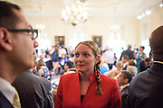 Annapolis, Maryland - May 12, 2015: Robin Dutta, representative for Maryland DC Virginia Solar energy industries association (MDV-SEIA), left, and Jessica Ennis, Earthjustice legislative representative joins those involved in crafting the community solar bill at the Maryland State House in Annapolis Tuesday May 12, 2015, for the bill's signing. <br /> CREDIT: Matt Roth for Earthjustice