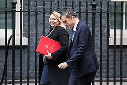 © Licensed to London News Pictures. 14/11/2017. London, UK. Secretary of State for Culture, Media and Sport Karen Bradley (L) and Conservative Chief Whip Julian Smith (R) arrive on Downing Street for the weekly Cabinet meeting. Photo credit: Rob Pinney/LNP