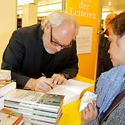 NLD/Amsterdam/20120310 - Feest der Letteren 2012 , Nico Dijkshoorn signeert boek