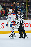 PENTICTON, CANADA - SEPTEMBER 17: Matt Benning #83 of Edmonton Oilers skates to the penalty box with an ice official against the Calgary Flames on September 17, 2016 at the South Okanagan Event Centre in Penticton, British Columbia, Canada.  (Photo by Marissa Baecker/Shoot the Breeze)  *** Local Caption *** Matt Benning;