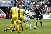 Aouar Houssem of Lyon and Toure Abdoulaye of Nantes and Djidji Lévy of Nantes and Gautier Antony referee during the French Championship Ligue 1 football match between Olympique Lyonnais and FC Nantes on April 28, 2018 at Groupama Stadium in Décines-Charpieu near Lyon, France - Photo Romain Biard / Isports / ProSportsImages / DPPI