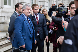 © Licensed to London News Pictures. 22/03/2019. London, UK. A group of Brexit supporters chant slogans at SNP Westminster Leader Ian Blackford (L) as he leaves the Cabinet Office in Westminster. The EU27 have agreed to Prime Minister Theresa May's request for a short extension to the deadline for leaving the European Union, offering two new deadlines depending on whether she is able to pass her deal next week. Photo credit: Rob Pinney/LNP