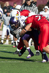 29 October 2005: Redbird Justin Martindale gets in on a double team to bring Leatherneck Travis Glasford to the ground. With a final score of 31 - 17, Western Illinois University Leathernecks collared the Illinois State University Redbirds knocking them from their 18th ranked perch at Hancock Field on Illinois State's campus in Normal IL