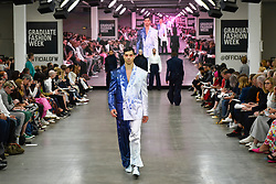 "© Licensed to London News Pictures. 05/06/2019. LONDON, UK.  A model presents a look by Christiana Alagna from Ravensbourne during the ""Best of GFW"" show on the final day of Graduate Fashion Week.  Taking place at the Old Truman Brewery in East London, the event presents the graduation show of up and coming fashion designers from UK and international universities.  Photo credit: Stephen Chung/LNP"