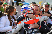 World Moto GP Championship.<br /> Round16.Phillip Island.Australia.Sunday16.10.2011.<br /> #27 Casey STONER (AUS) Repsol Honda Team.<br /> Wins the race and is crowned the 2011 Moto GP Champion on his 26th birthday.<br /> Here greeted by his team crew chief, as his wife Adriana looks on.<br /> © ATP Photo/ Damir IVKA<br /> Motorrad-WM - MotoGP in Australien - Motorrad - Moto GP -Motorradsport - Grand Prix in Phillip Island - Motorcycle racing in Australia - Moto2 - 16.10.2011 - <br /> - fee liable image - Photo Credit: © ATP / Damir IVKA