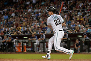 Sep 8, 2017; Phoenix, AZ, USA; Arizona Diamondbacks infielder Jake Lamb (22) hits an RBI double in the sixth inning against the San Diego Padres at Chase Field. Mandatory Credit: Jennifer Stewart-USA TODAY Sports