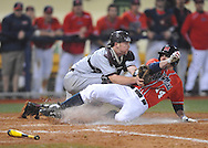 Mississippi's Cameron Dishon (14) is tagged out by Arkansas-Little Rock catcher Drew Merten (11) at Oxford-University Stadium in Oxford, Miss. on Friday, March 7, 2014. Ole Miss won 2-1 in ten innings. (AP Photo/Oxford Eagle, Bruce Newman)