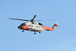May 27, 2017 - County Dublin, Ireland - Missing fisherman Irish Sea search. A a Irish coast helicopter searches the coastline at Skerries, as a search and rescue operation is under way for a missing fisherman after a boat sank in the Irish Sea. (Credit Image: © John Rooney/Pacific Press via ZUMA Wire)