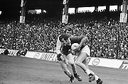 Galway player shoulders past Dublin as he runs with the ball during the All Ireland Senior Gaelic Football Championship Final Dublin V Galway at Croke Park on the 22nd September 1974. Dublin 0-14 Galway 1-06.