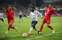 England's Danny Rose runs at Montenegro's Fillip Stojkovic (2) and Montenegro's Mirko Ivanic (20)