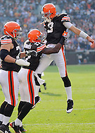 Cleveland receiver Braylon Edwards, center, celebrates with quarterback Derek Anderson after a  28-yard TD pass  in the third quarter. Kevin Shaffer is to the left for the Browns..