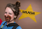 A staff member has pudding on her face after a contest during a pep rally to energize students for STAAR testing at Garcia Elementary School, March 27, 2014.