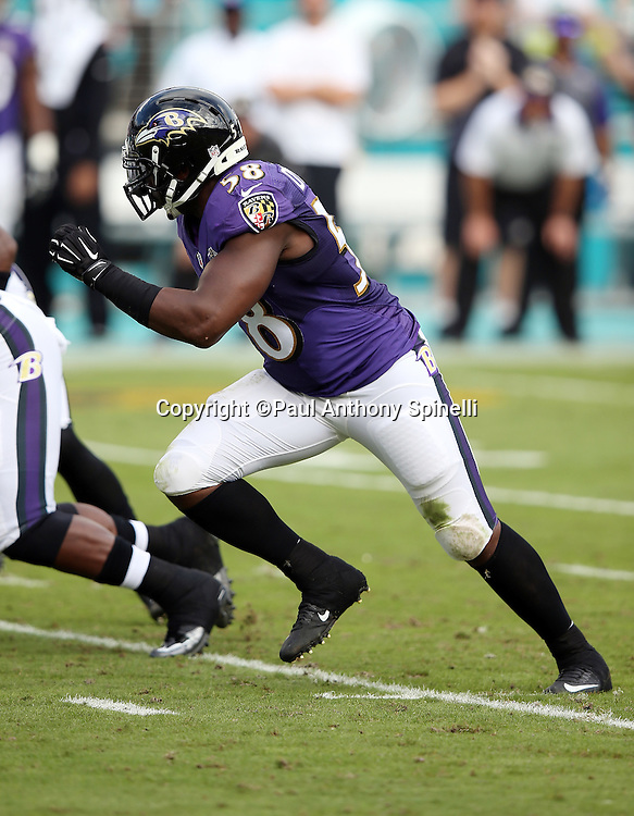Baltimore Ravens outside linebacker Elvis Dumervil (58) chases the action during the 2015 week 13 regular season NFL football game against the Miami Dolphins on Sunday, Dec. 6, 2015 in Miami Gardens, Fla. The Dolphins won the game 15-13. (©Paul Anthony Spinelli)