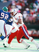 Houston Oilers offensive lineman Bruce Matthews (74) blocks Philadelphia Eagles defensive end Reggie White (92) during the 1990 NFL Pro Bowl between the National Football Conference and the American Football Conference on Feb. 4, 1990 in Honolulu. The NFC won the game 27-21. (©Paul Anthony Spinelli)