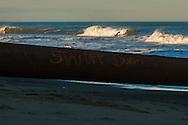Feb 27, 2013; Virginia Beach; VA; A surf catches a wave near 25th Street. Mandatory Credit: Peter J. Casey