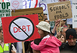 © licensed to London News Pictures. 14/05/2011. London, UK. People attempting to disrupt The Rally Against Debt held in Westminster. London today (14/05/2011) by holding up pro cuts banners. Organisers of the pro-cuts demonstration include the Taxpayers' Alliance group. Please see special instructions for usage rates. Photo credit should read Ben Cawthra/LNP