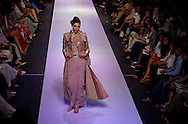 A model presents a creation by Indian designer Ritu Beri at the Lakme Fashion Week in Bombay, India, Saturday, April 1, 2006. (AP Photo/Sebastian John)
