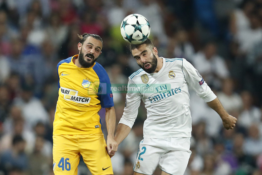 (L-R) Stathis Aloneftis of APOEL FC, Daniel Carvajal of Real Madrid during the UEFA Champions League group H match between Real Madrid and APOEL FC on September 13, 2017 at the Santiago Bernabeu stadium in Madrid, Spain.