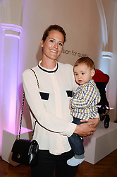 LADY KATE BONAS and her son OSSIE BONAS at a children's tea party to celebrate the 80th anniversary of iCandy - the luxury British pushchair brand held at One Marylebone, Marylebone Road, London NW1 on 10th September 2013.