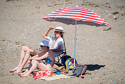 © Licenced to London News Pictures<br /> 26 June 2018 . Aberystwyth Wales UK<br /> <br /> UK Weather:  On another scorchingly hot day at the seaside in Aberystwyth, people flock to the beach and sea to top up their tans and cool down  a little in the clear shallow  waters of Cardigan Bay<br /> The UK is in the grips of a mini heatwave, with temperatures widely  forecast to reach over  30º Celsius in many parts of the country<br /> photo Credit Keith Morris / LNP