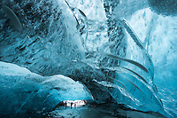 People exploring an Ice Cave in Vatnajökull glacier, Southeast Iceland.