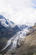 The Pasterze, at approximately 8.4 kilometers (5.2 mi) in length, is the longest glacier in Austria and in the Eastern Alps reaching from the 3,453-metre (11,329 ft) Johannisberg to 2,100 metres (6,900 ft) above sea level. It lies within the Hohe Tauern mountain range in Carinthia, directly beneath Austria's highest mountain, the Grossglockner.
