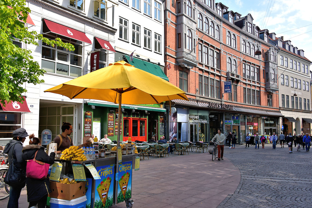 Str&oslash;get Shopping District in Copenhagen, Denmark <br /> Str&oslash;get is the main shopping district in central Copenhagen. The cobblestoned, pedestrian street stretches for 1.1 kilometers which make it one of the longest in Europe.  It is flanked by charming often historic buildings including one that dates back to 1616. Here you will find anything you need, from luxury retailers to street vendors for a quick bite to eat.