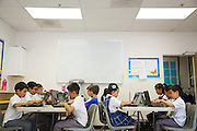 Students use laptop computers at Monarch Christian Academy in Milpitas, California, on September 12, 2014. (Stan Olszewski/SOSKIphoto)