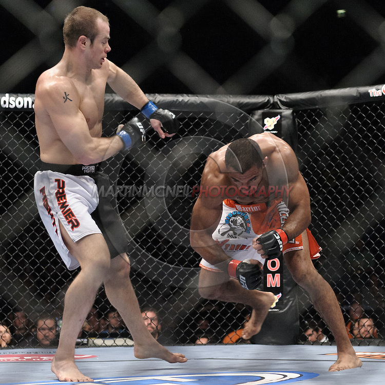 """LONDON, ENGLAND, JUNE 7, 2008: Kevin Burns (left) turns away from Roan Carneiro during """"UFC 85: Bedlam"""" inside the O2 Arena in Greenwich, London on June 7, 2008."""