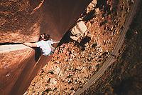Bowe Ellis nears the top of Super Crack of the Desert, 5.10, Indian Creek, Utah.