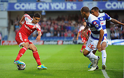 Swindon Town's Massimo Luongo takes on the QPR defence  - Photo mandatory by-line: Seb Daly/JMP - Tel: Mobile: 07966 386802 27/08/2013 - SPORT - FOOTBALL - Loftus Road - London - Queens Park Rangers V Swindon Town -  Capital One Cup - Round 2