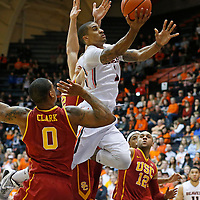 Oregon State's Gary Payton II, center, drives to the basket past USC's Darion Clark, left, and Julian Jacobs, right, in the second half of an NCAA college basketball game in Corvallis, Ore., on Sunday, Jan. 24, 2016. Oregon State won 85-70. (AP Photo/Timothy J. Gonzalez)