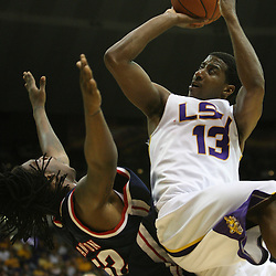 14 February 2009 LSU guard Terry Martin (13) shoots over DeAundre Cranston (52) of Ole Miss during a NCAA basketball game between SEC rivals the Ole Miss Rebels and the LSU Tigers at the Pete Maravich Assembly Center in Baton Rouge, LA.